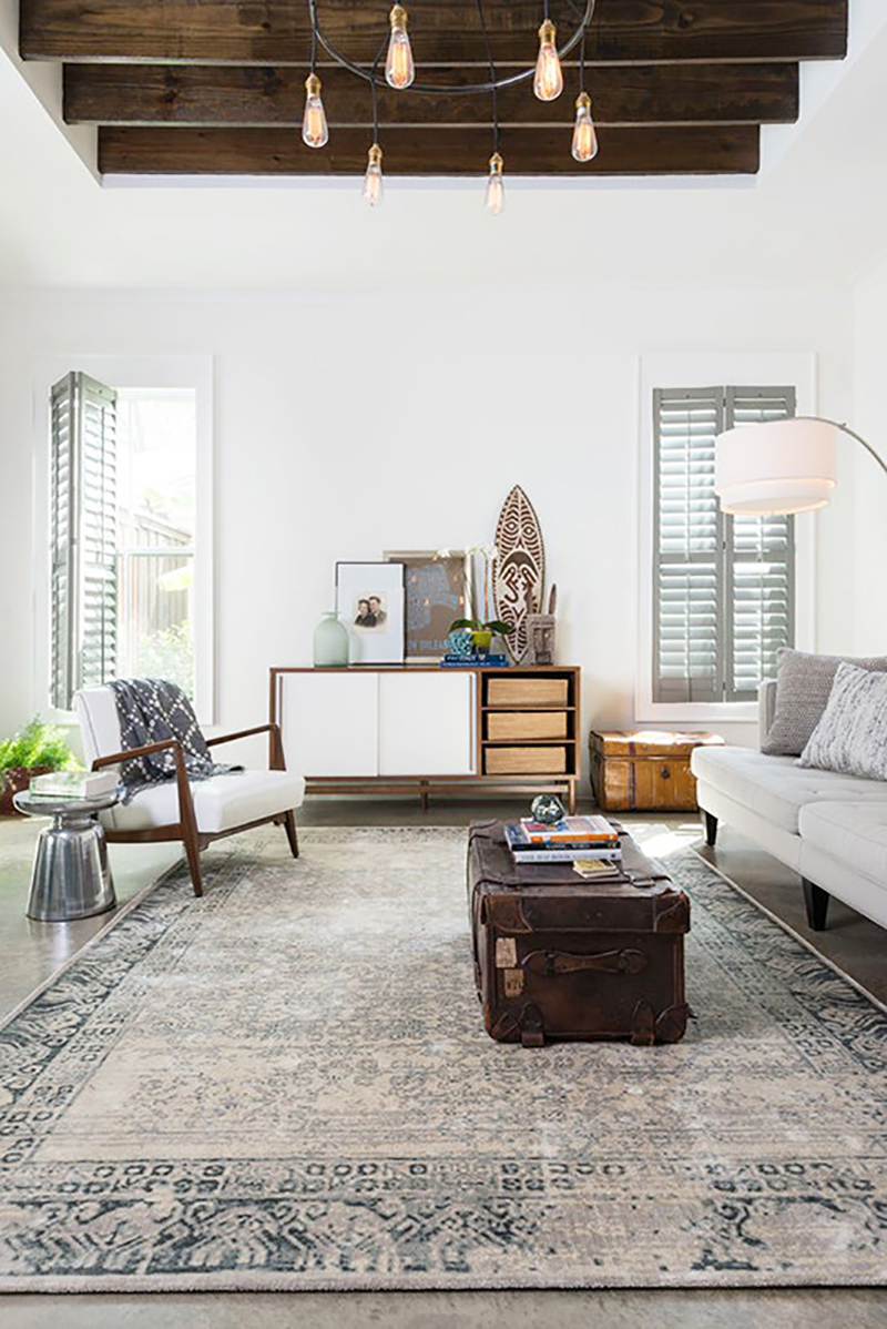 traditional rug with mid century furniture