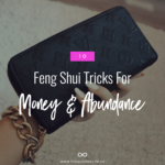 manicured hand holding wallet with text 10 Feng Shui Tricks for Money And Abundance